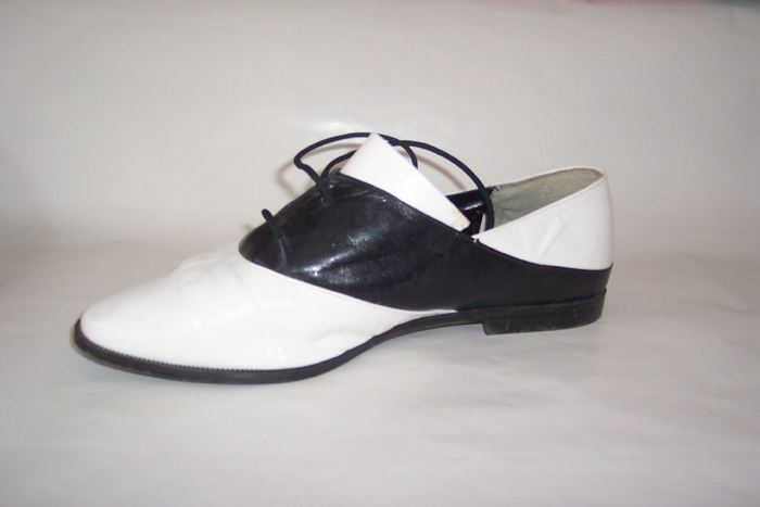 Description: White with Black, similar in style to saddle shoes from late